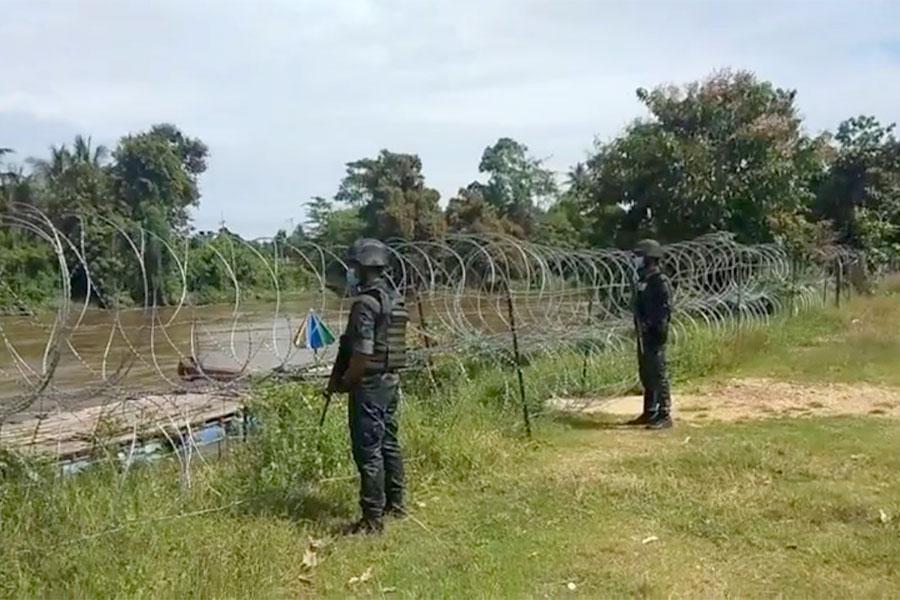 Колючая проволока на границе Малайзии и Таиланда