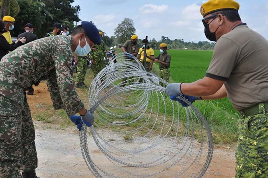 Колючий дріт проти Covid-19 в Малайзії